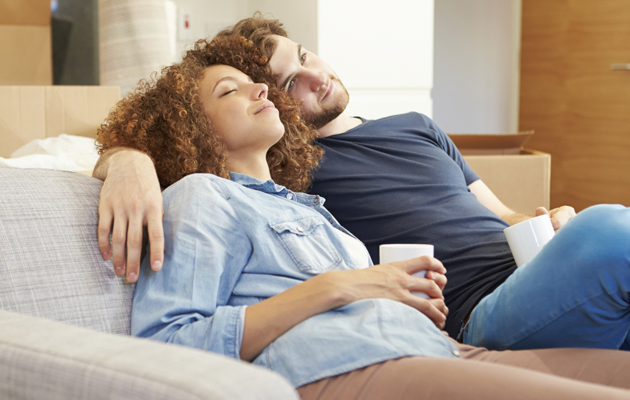 A young couple is having a relaxing time on a couch